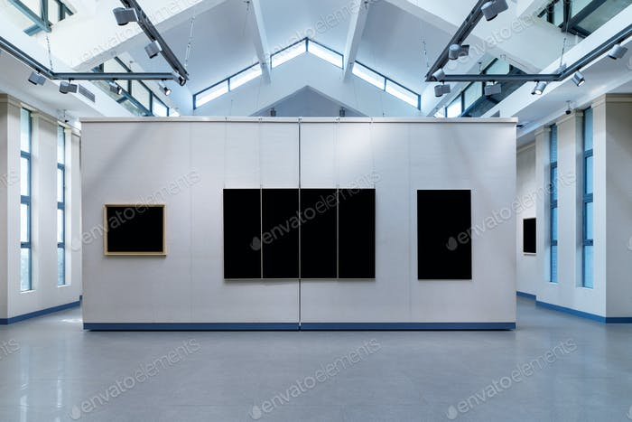 blank picture frames on exhibition wall