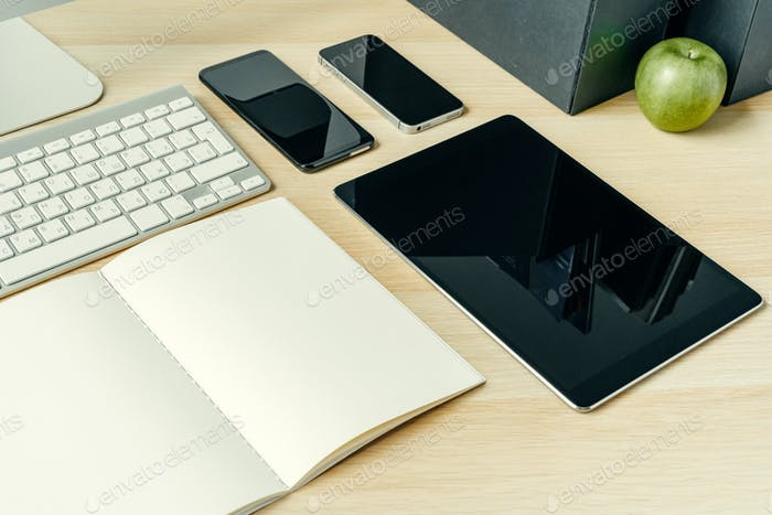 Close up shot of digital devices on office table