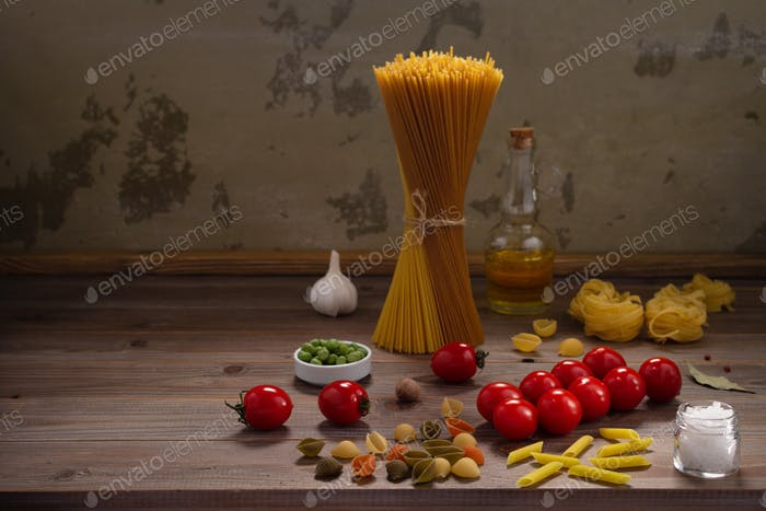 Pasta and food ingredient on wooden table background. Raw pasta assortment of italian food