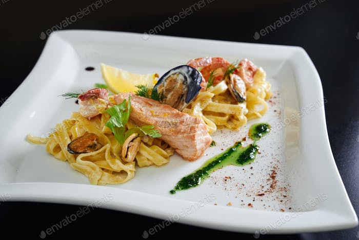 Pasta with seafood on white plate