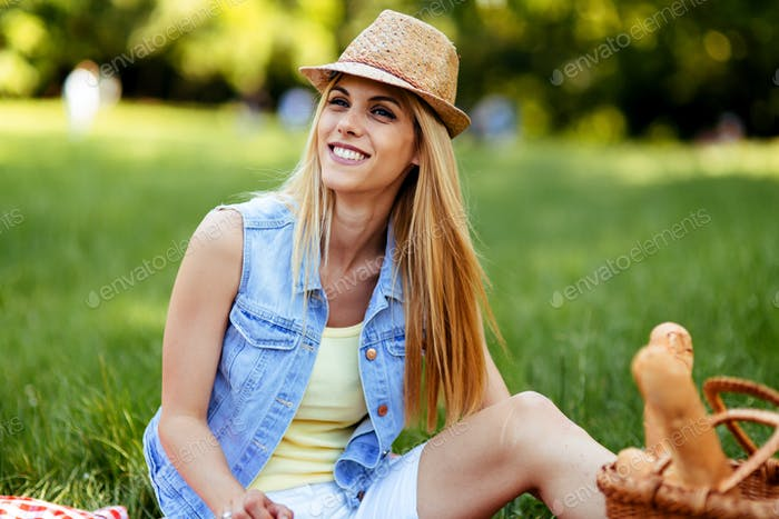 Happy woman enjoying free time on picnic