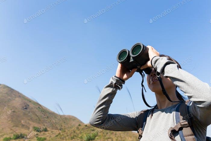 Young Woman looking though binocular