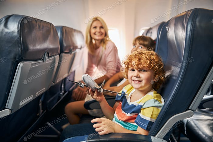Cheerful child playing with a toy airplane