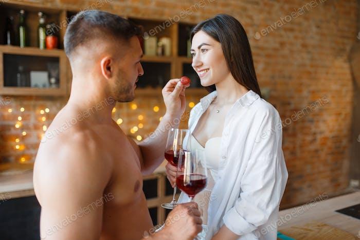 Sensual couple spend romantic dinner on kitchen
