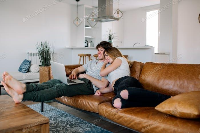 Cheerful couple on sofa