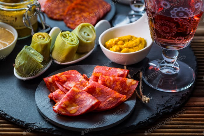 Assortment of tapas and antipasti on black background