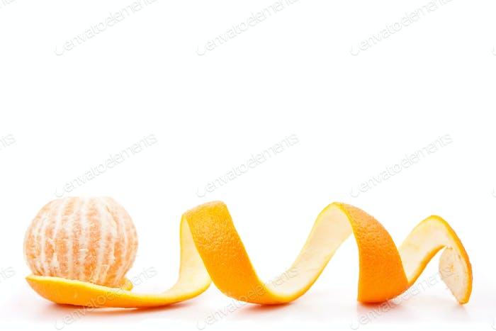 Orange posed on a orange peel against white background