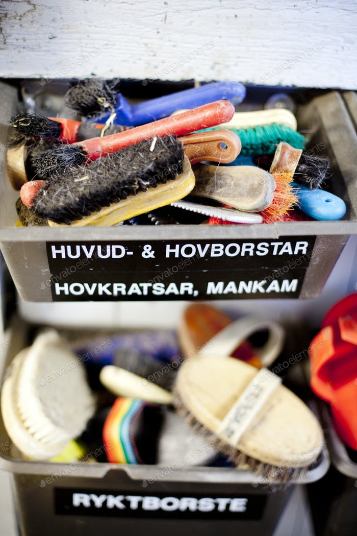 High angle view of abandoned brushes in drawers