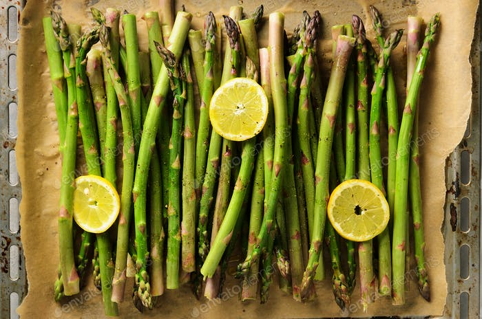 Baked asparagus with lemon. Raw, vegan, vegetarian and clean eating concept