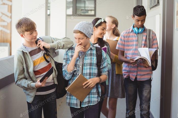 Group of classmate walking in corridor
