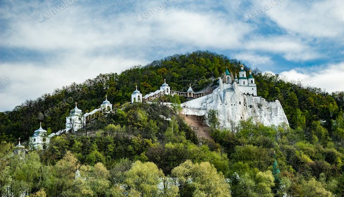 Beautiful scenic view of the monastery covered with green trees