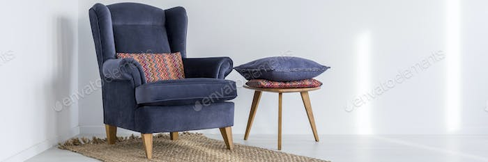Armchair and stool with pillows