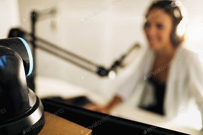 Young Woman Recording Video Podcast in Studio