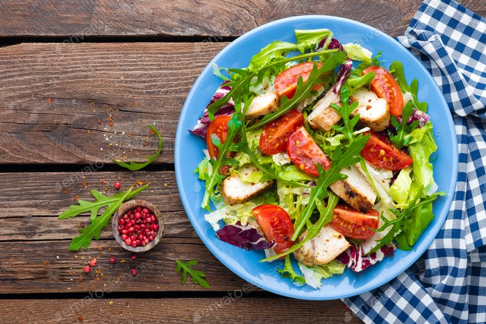 Vegetable salad with chicken meat. Salad with fresh vegetables and grilled chicken fillet