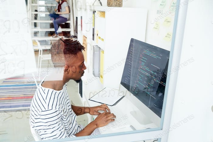 Programmer by computer