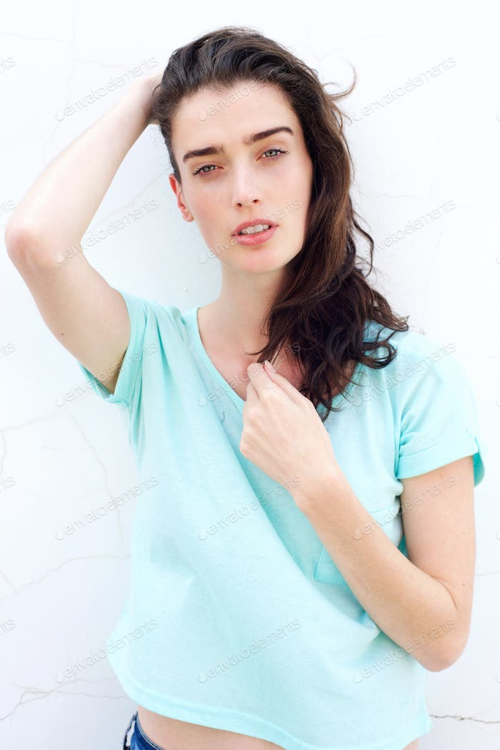 Attractive young woman with hand in hair