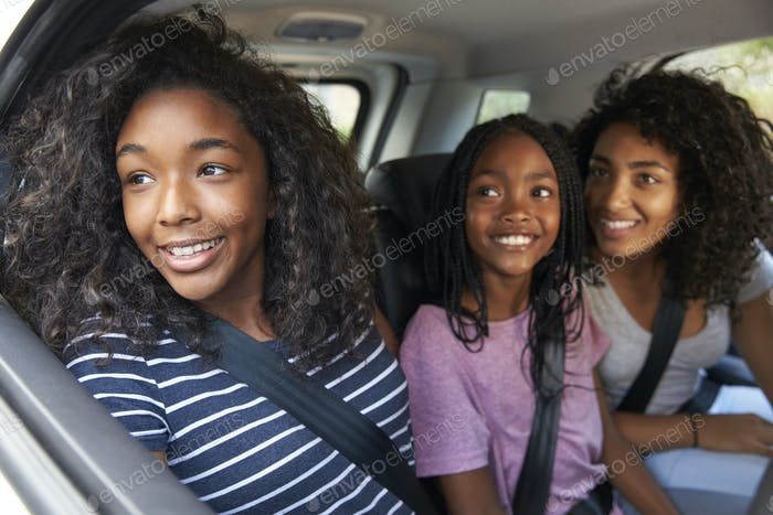 Family With Teenage Children In Car On Road Trip