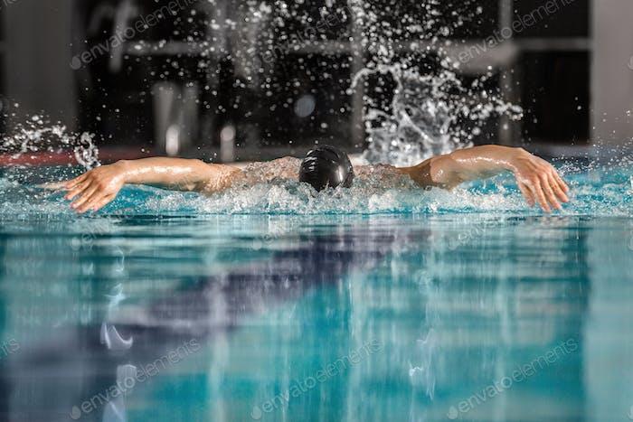 Male swimmer swimming the butterfly stroke