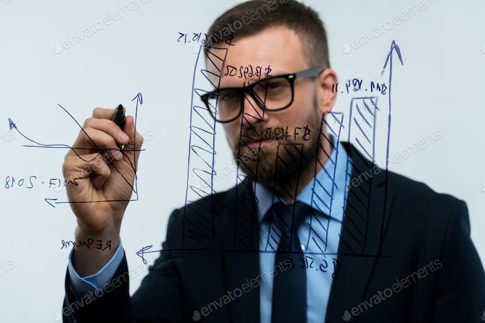 Man draws various growth charts, calculating prospects for succe