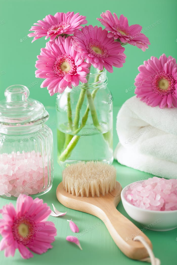 spa aromatherapy with gerbera flowers saltl brush