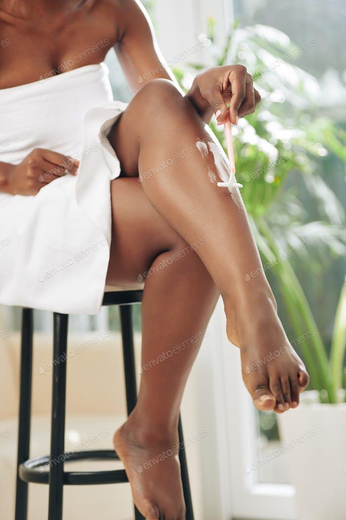Unrecognizable Woman Shaving Legs