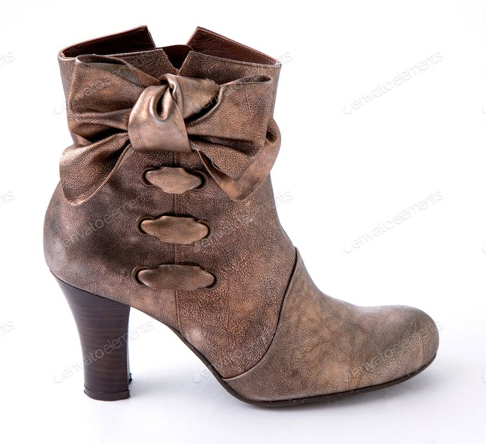 Worn metalized texturized leather bootie with big bow