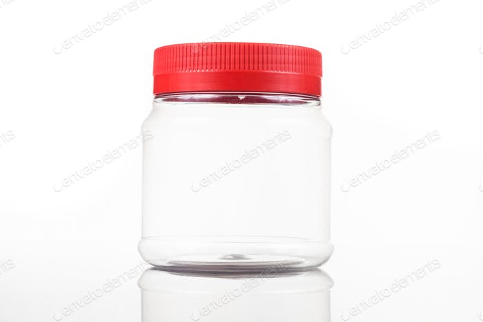 Small translucent plastic PVC jar with red cover isolated in white