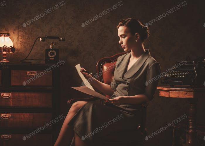 Beautiful woman reading in retro interior