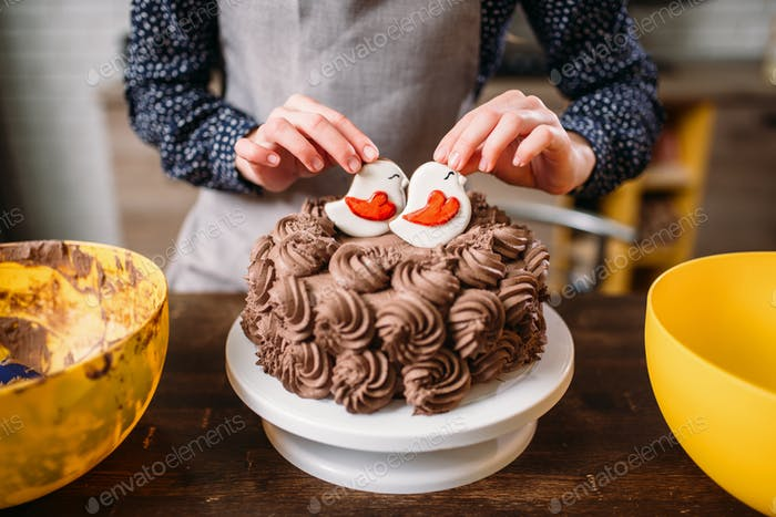 Decoration of chocolate cake with cookies in glaze