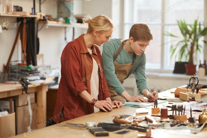 Man And Woman Working On Leathercraft