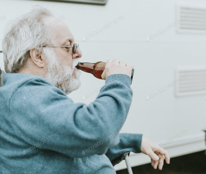 Senior man enjoying a bottle of beer