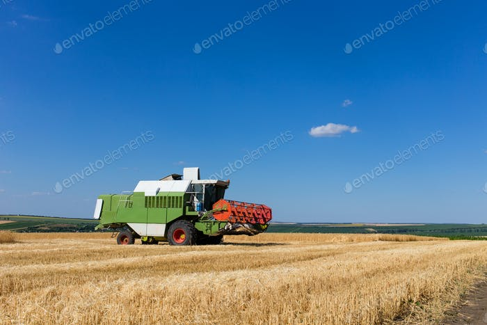 Combine harvester working on a wheat field.