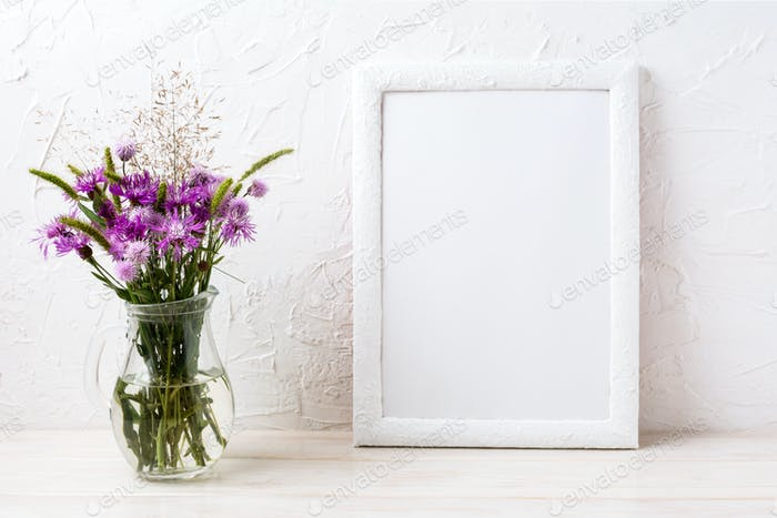 White frame mockup with burdock flowers in the jug