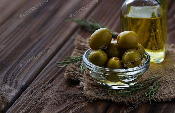 Olives and bottle of olive oil