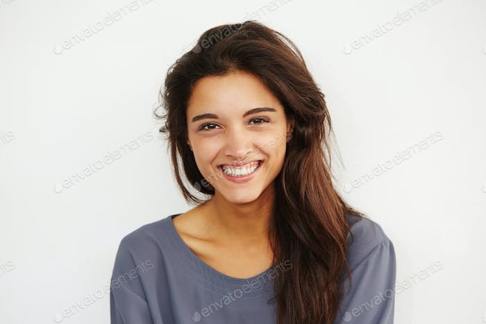 beautiful female smiling against white background