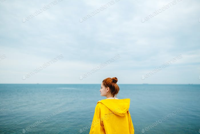 Girl posing on background of ocean