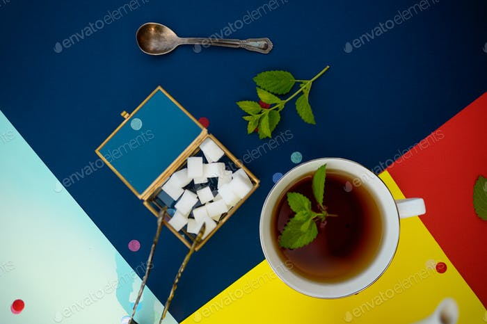 Table setting, tea with mint, teacup and sugar
