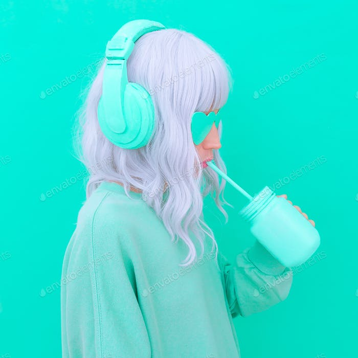 Dj girl drink fresh Smoothie. Minimal aesthetic monochrome fashion design. Aqua menthe color trend