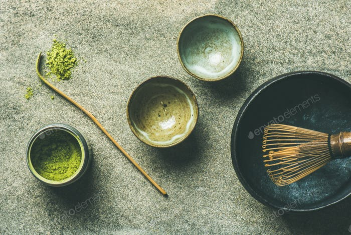 Japanese tools for brewing matcha tea, grey background, top view