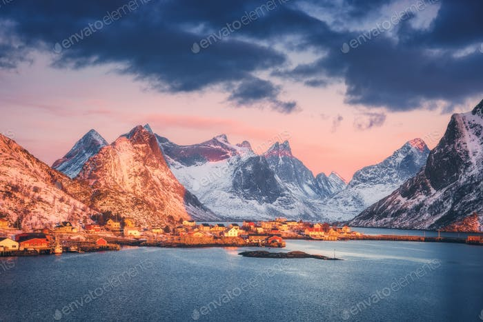 Reine village and snow covered mountains at beautiful sunrise