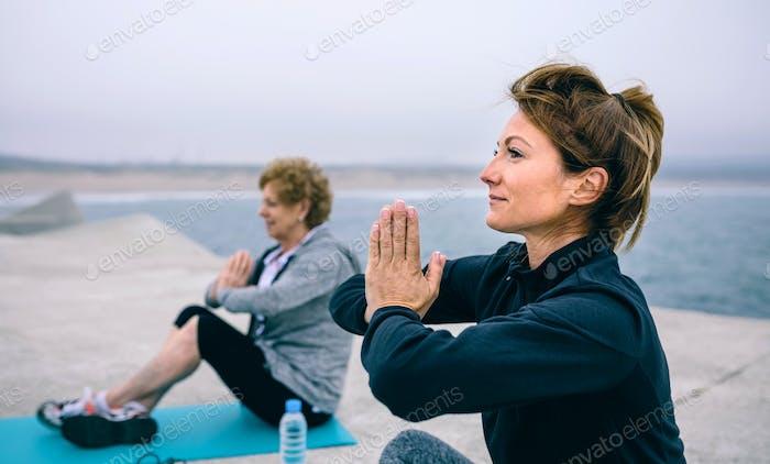 Women exercising in a concrete pier