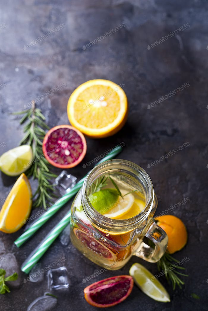Jar of lemonade with citrus fruits