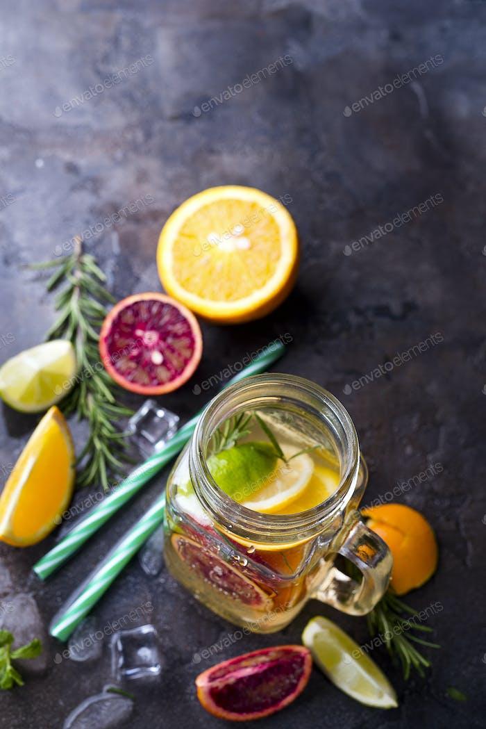 Jar of lemonade with citrus fruits