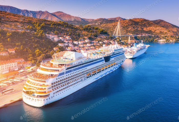 Aerial view of beautiful large white cruise ships at sunset