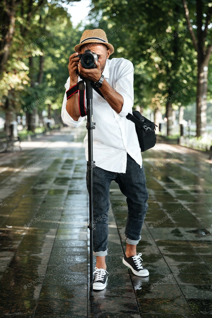 Fashionable black man in park