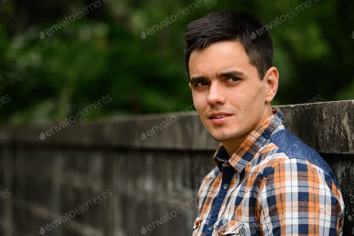 Handsome hipster man in the streets outdoors