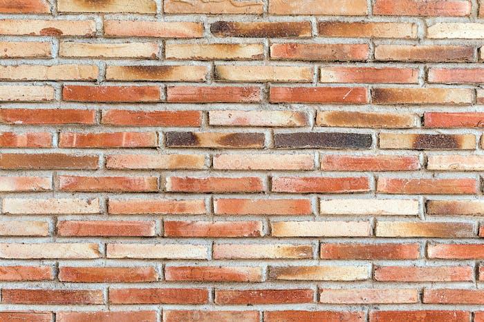 Alte und robuste rote Mauerwand
