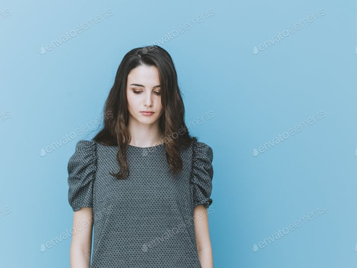Elegant girl looking down