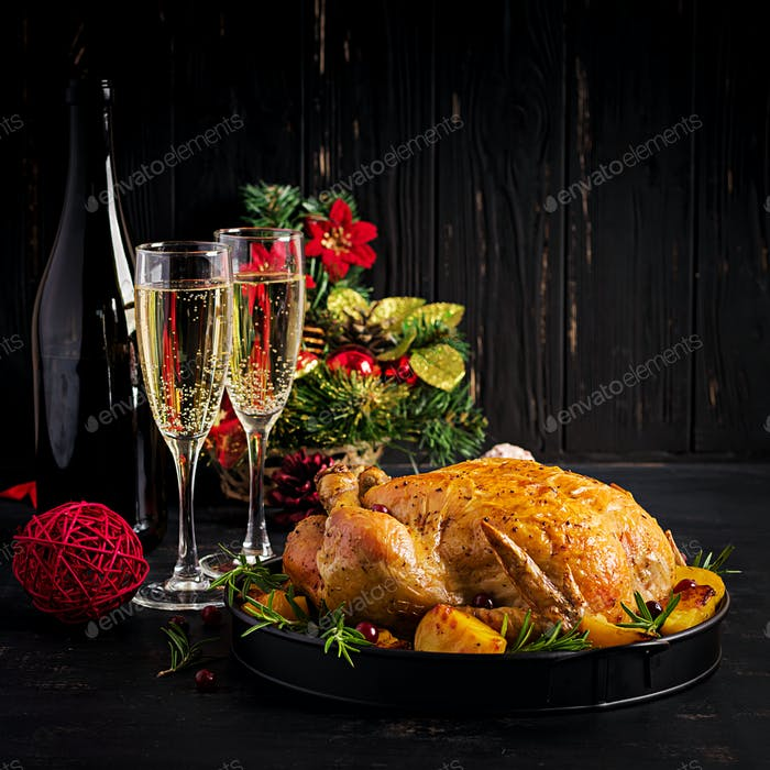 Baked turkey or chicken. The Christmas table is served with a tu