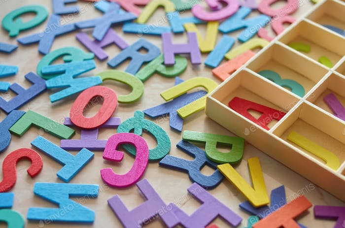 The colorful wooden alphabet toy